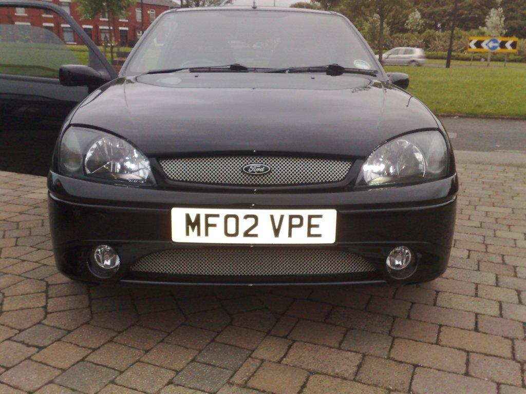 and white ford badge.